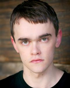Headshot of actor Brian Vernel who is a graduate of the RCS BA Acting programme